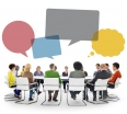 Group of People in Meeting with Speech Bubbles