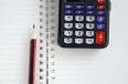 pen, calculator and notebook